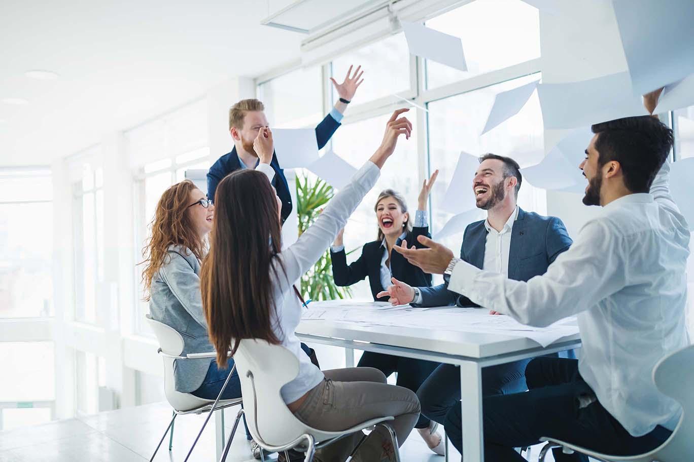 successful-business-people-celebrating-achieved-bu-HAZ2DL9